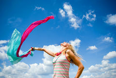 Beautiful young girl jumping in a sunny day Stock Images