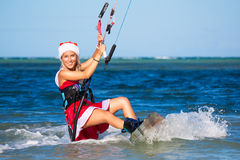 Beautiful young girl on the kite in the costume of Santa Claus. Stock Photography
