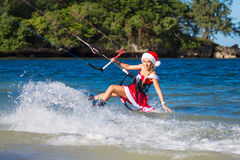 Beautiful young girl on the kite in the costume of Santa Claus. Royalty Free Stock Photos