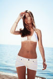 Beautiful young girl in a knitted swimsuit and shorts Royalty Free Stock Photo