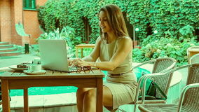 Beautiful young girl with laptop stock video