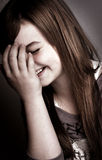 Beautiful young girl laughing Stock Images