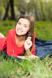 Beautiful young girl laying in park Royalty Free Stock Photo