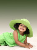 Beautiful Young Girl Laying In the Sand Stock Photo