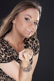 Beautiful young girl in a leopard dress royalty free stock photos