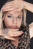 Beautiful young girl in a leopard dress Stock Photos