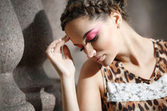 Beautiful young girl in a leopard print dress stock photos