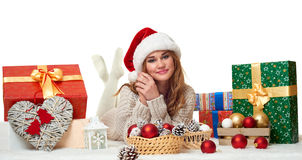 Beautiful young girl lie in santa hat with gift boxes - holiday concept Stock Image
