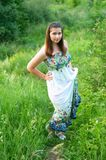 Beautiful young girl in light dress Royalty Free Stock Photography