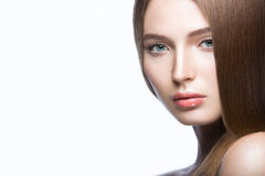 Beautiful young girl with a light natural make-up. Beauty face. Royalty Free Stock Photography