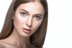 Beautiful young girl with a light natural make-up. Beauty face. stock photo