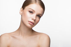 Beautiful young girl with a light natural make-up. Beauty face. Stock Photos