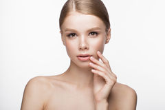 Beautiful young girl with a light natural make-up and French manicure. Beauty face. Stock Photography