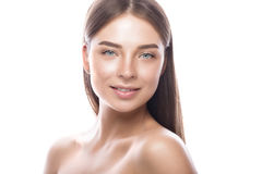 Beautiful young girl with a light natural make-up and perfect skin. Beauty face. Picture taken in the studio on a white background stock images
