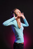 Beautiful young girl listen music royalty free stock images