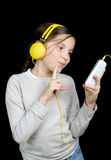 A beautiful young girl listening to music with headphone Stock Photo