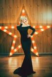 Beautiful young girl in a long black dress Stock Photos