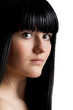 Beautiful young girl with long black hair. On white background royalty free stock photo