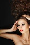 Beautiful young girl with long brown hair Stock Photos