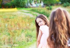 Beautiful young girl with long brunette hair, looking to camera. At sunny day. Having fun of joyful kid. Place for text Stock Photos