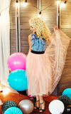 Beautiful young girl with long curly blond hair. A girl in an airy tutu Royalty Free Stock Images