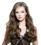 Beautiful young girl with long curly hairs royalty free stock photography