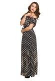 A beautiful young girl in a long dress posing Stock Photos