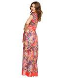 A beautiful young girl in a long dress posing Royalty Free Stock Photos