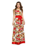 A beautiful young girl in a long dress posing Stock Image