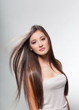 Beautiful young girl with long hair Stock Photos
