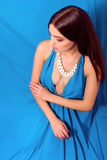 Beautiful young girl with long hair in a long blue dress Stock Images