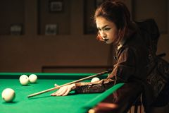 Girl in the billiard room stock photography