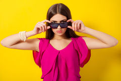 Beautiful young girl with long hair in a purple blouse Royalty Free Stock Image