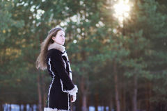 Beautiful young girl with long hair standing in the forest Stock Photography