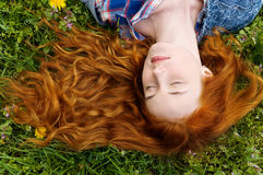 Beautiful young girl with long red curly hair Stock Photos