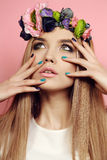 Beautiful young girl with long straight hair with bright  flower's headband Royalty Free Stock Images