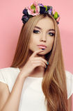 Beautiful young girl with long straight natural hair with bright  flower's headband Royalty Free Stock Photo