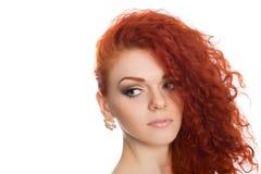 Beautiful young girl looking away. Beautiful red haired young girl looking away Royalty Free Stock Image