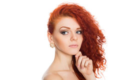 Beautiful young girl looking away. Beautiful red haired young girl looking away. Isolated on white Royalty Free Stock Images