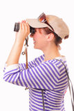 Beautiful young girl looking through binoculars Stock Photo