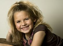 Beautiful young girl looking towards the viewer Royalty Free Stock Photography