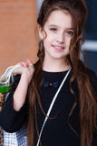 Beautiful young girl with a lot of packages at the outlet of the Royalty Free Stock Photo