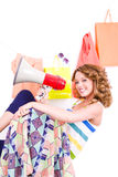 Beautiful young girl with loudspeaker in colorful dressing room Royalty Free Stock Images