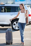 Beautiful young girl with luggage near her Royalty Free Stock Photo