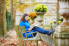 Beautiful young girl in the Luxembourg garden of Paris. On a fall day royalty free stock images
