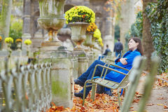 Beautiful young girl in the Luxembourg garden of Paris. On a fall day royalty free stock image