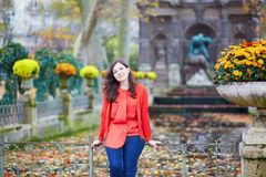 Beautiful young girl in the Luxembourg garden of Paris. On a fall day royalty free stock photo