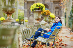 Beautiful young girl in the Luxembourg garden of Paris. On a fall day stock photo