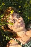 Beautiful young girl lying on grass Royalty Free Stock Photo