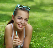 Beautiful young girl with lying on the grass Royalty Free Stock Photos